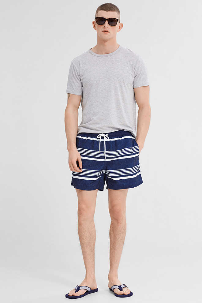 Esprit / Woven swim shorts with a print and stripes