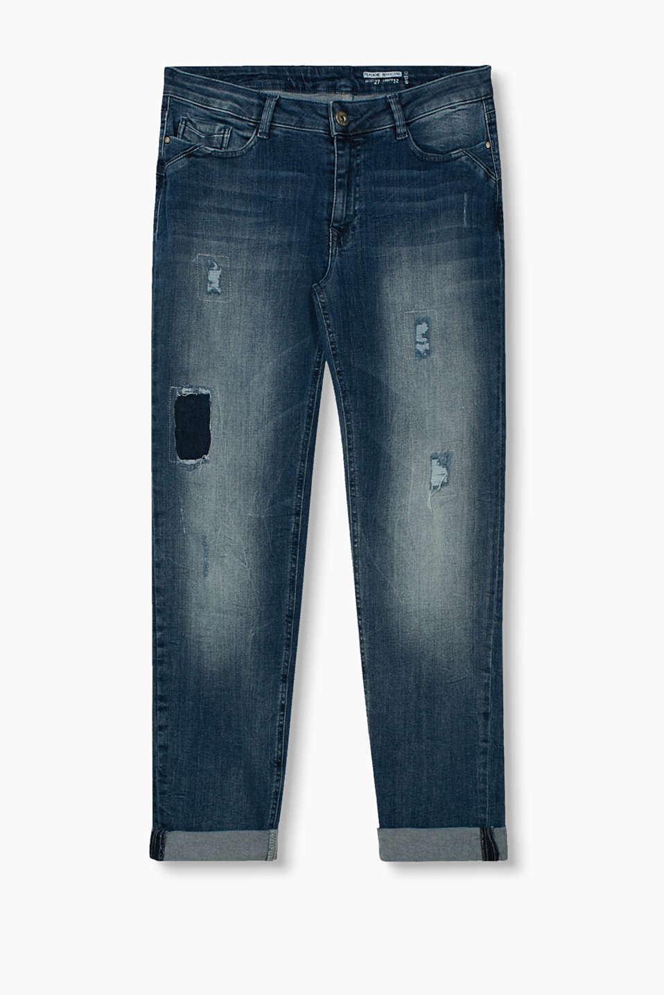 with faced holes, faded areas and 2-tone back pockets