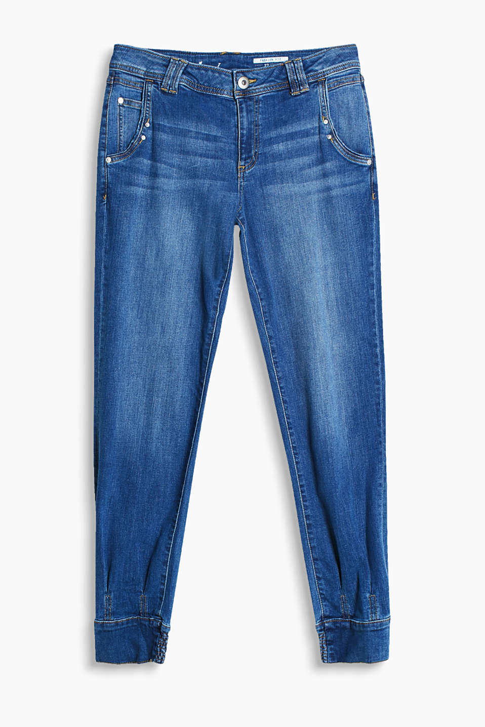 Relaxed jeans with washed-out effects and button-fastening elasticated cuffs on the leg hems