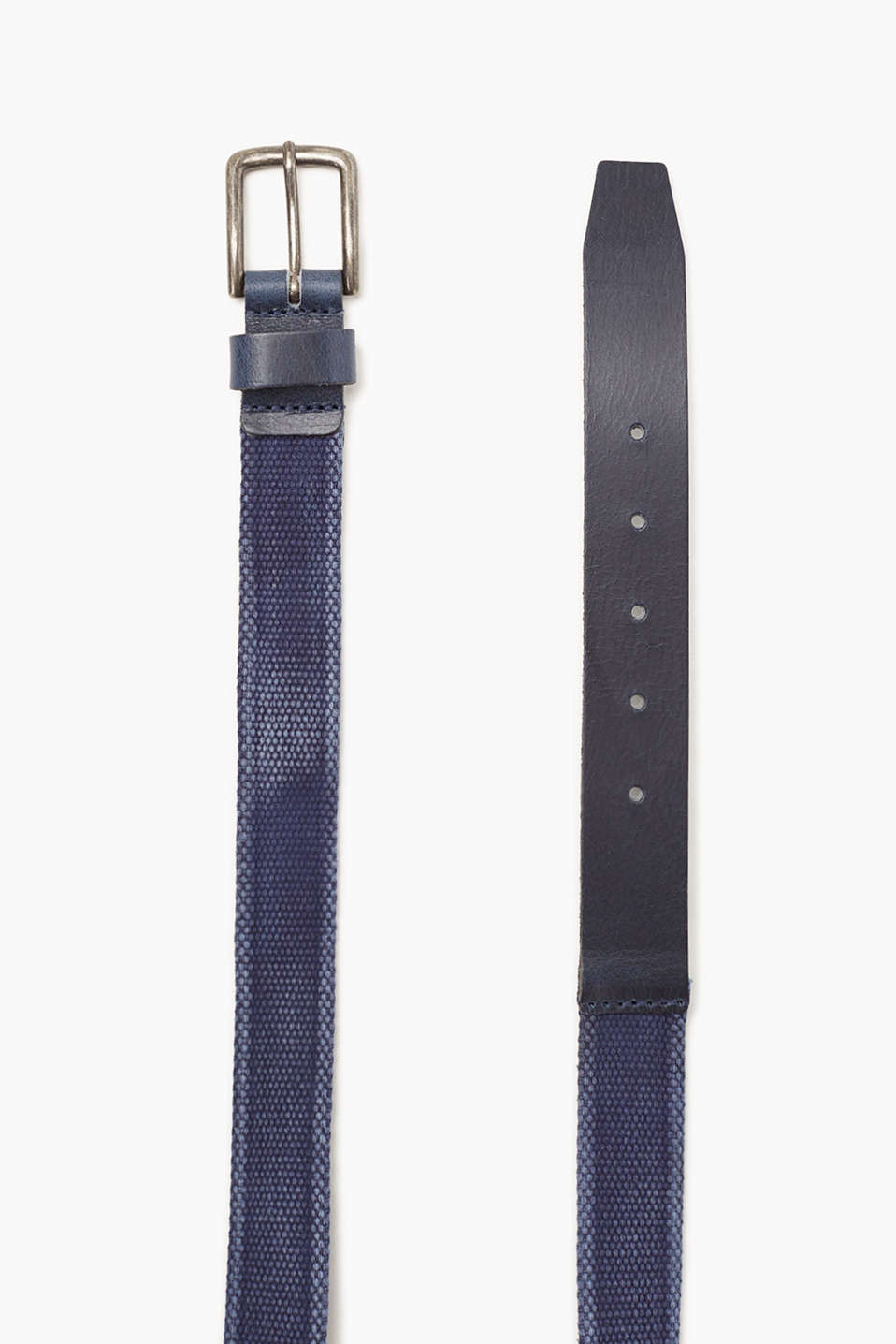 In a garment-washed finish: Woven belt in cotton with a buffalo leather trim