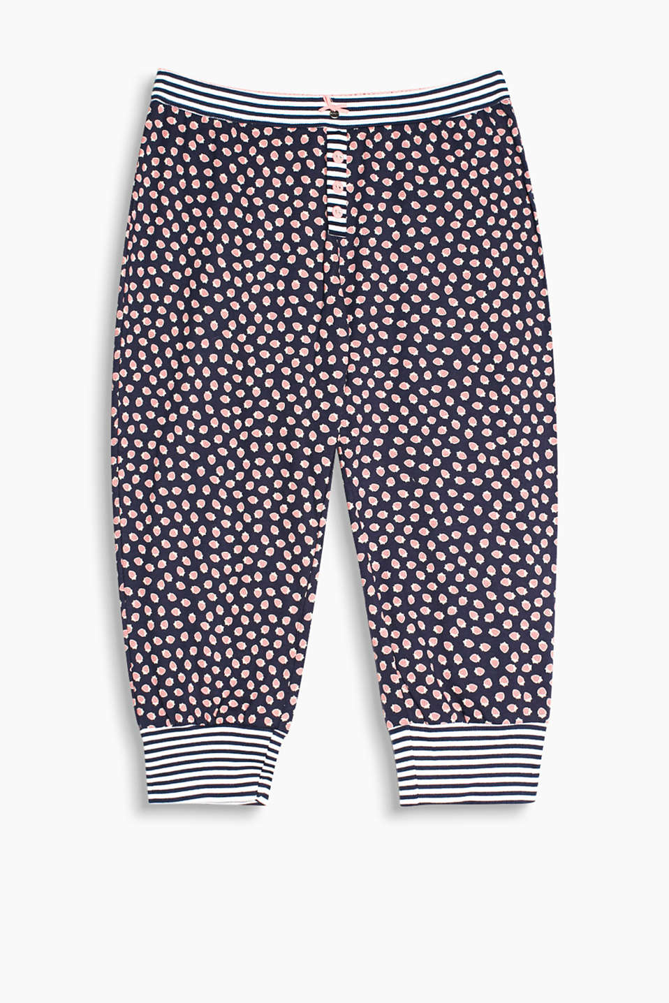Tracksuit bottoms with a large strawberry print, cuffed legs and an attached waistband