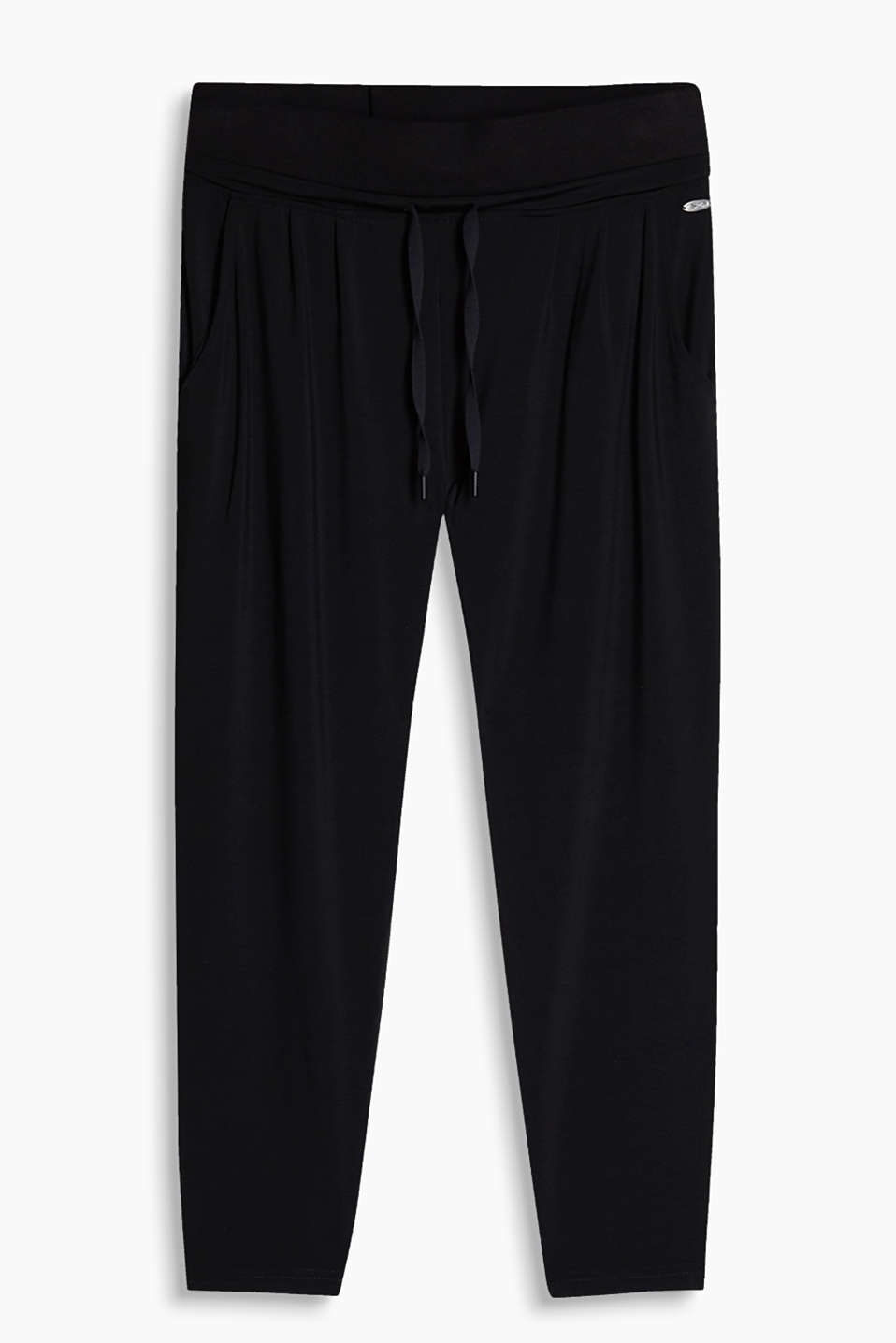 Loose capris with a wide waistband and waist pleats, made of stretchy jersey