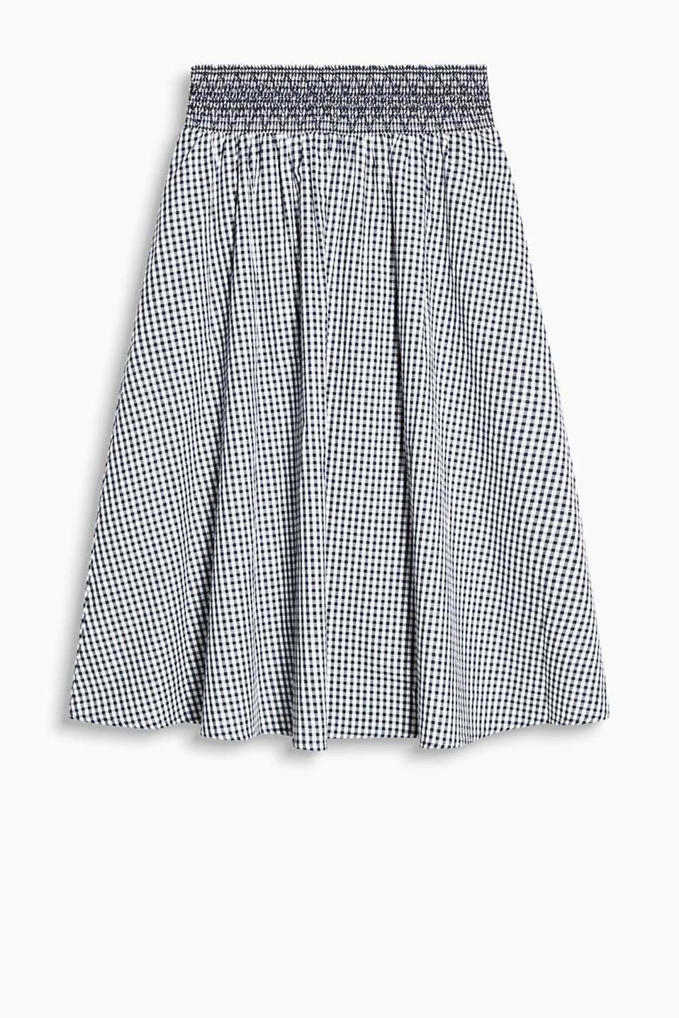 With a smocked waistband: flared midi skirt in cotton