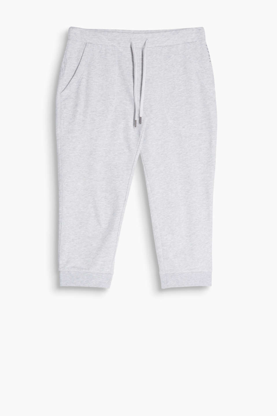 Tracksuit bottoms with elasticated drawstring ties and a modern 3/4-length leg with a cuff