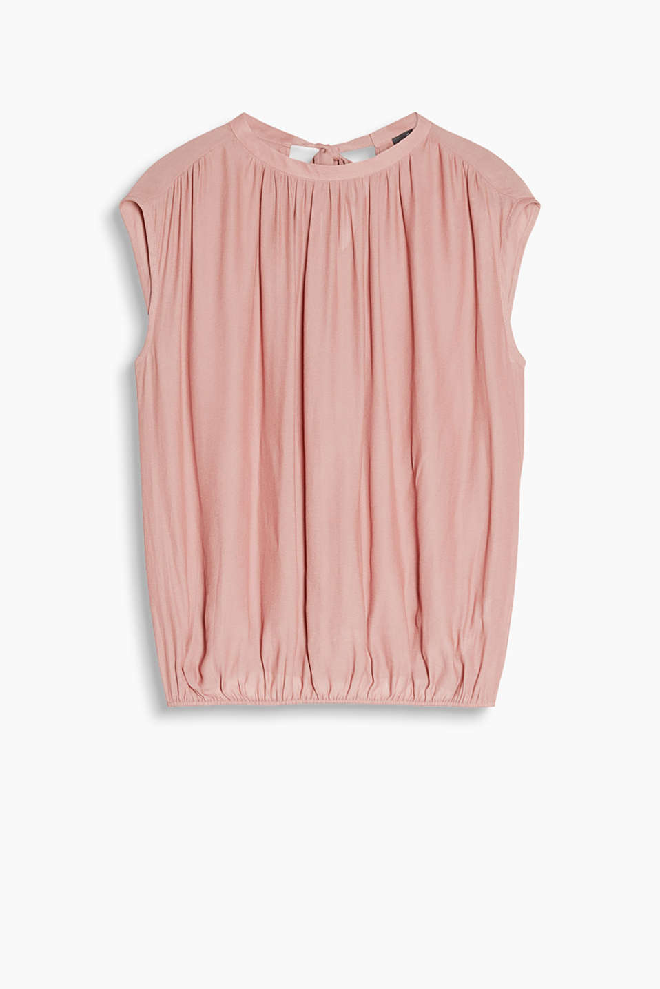 Semi-sheer blouse top in flowing fabric with a bow on the back