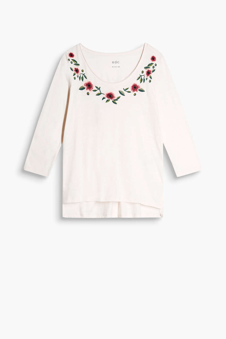 Long sleeve top in 100% cotton with bold floral embroidery along the beautiful round neckline