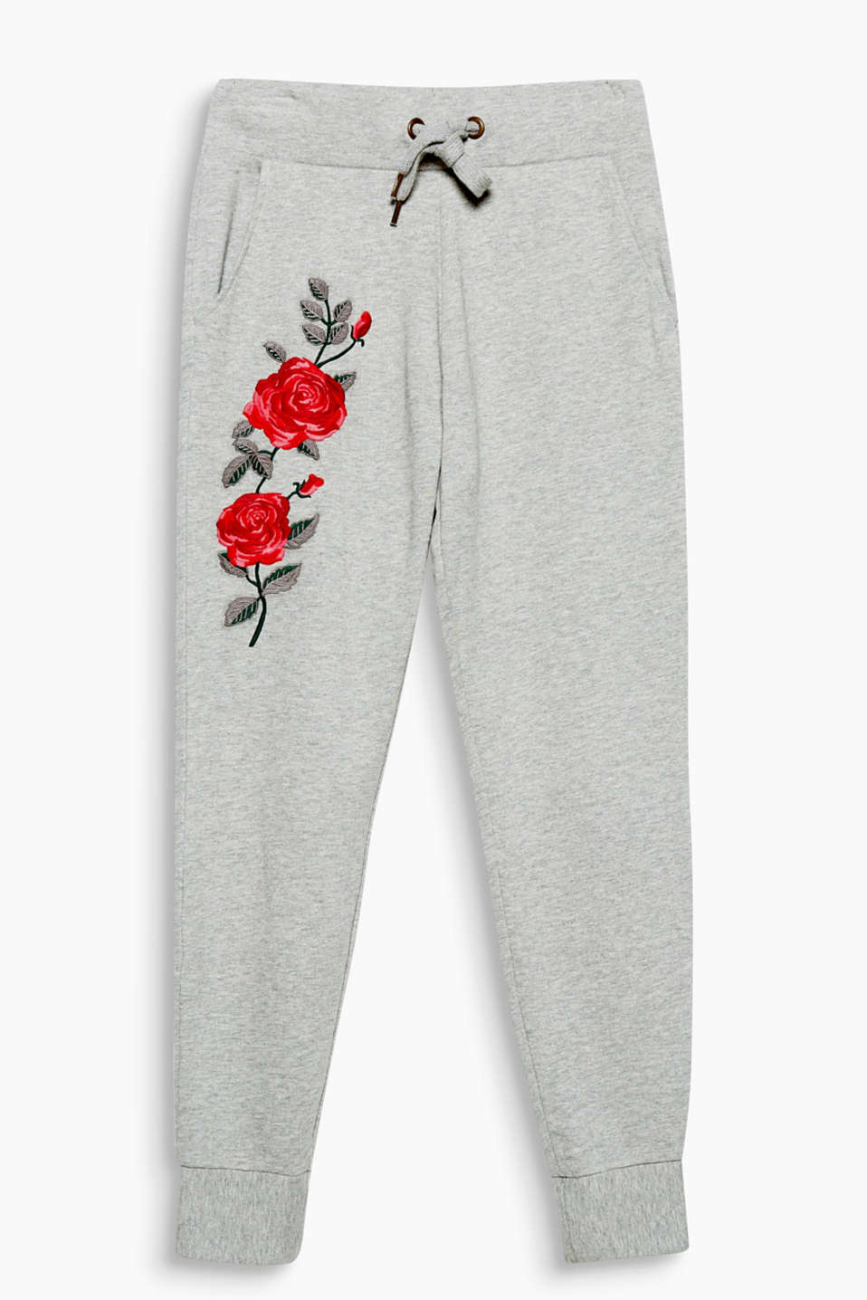 See how pretty the new sportswear can be: melange tracksuit bottoms with elaborate rose embroidery