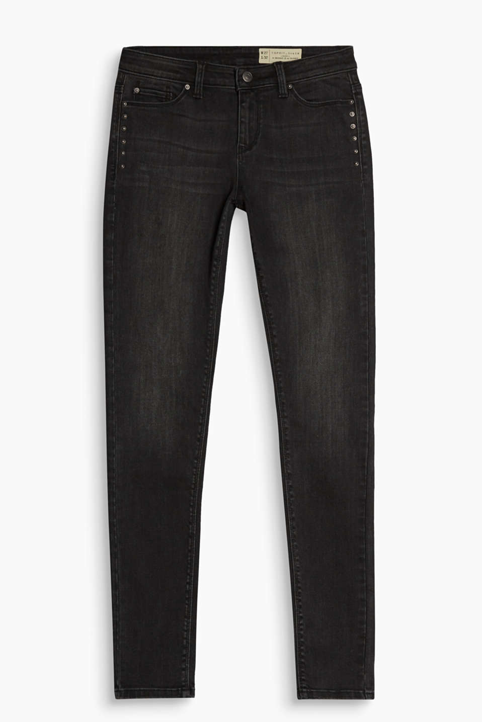Subtle punk style: skin-tight black denim stretch jeans with stud-embellished front pockets