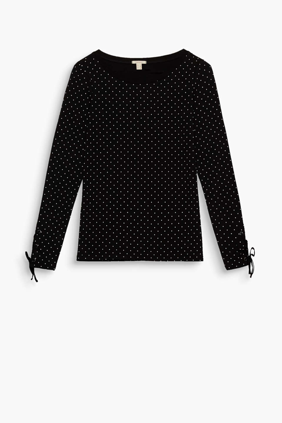 This long sleeve top in stretch cotton with a pretty polka dot print has cool lacing on the sleeve ends.
