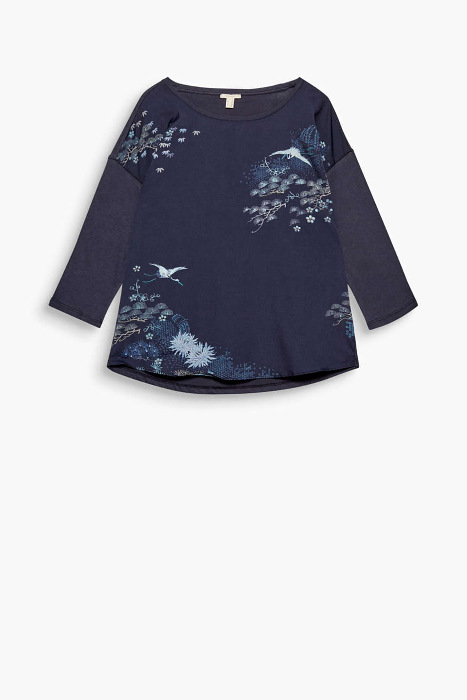 Feed your wanderlust and enjoy the way this floaty blouse with a decorative oriental print feels against your skin!