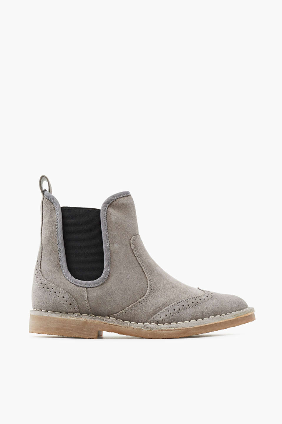 Smart look, cosy comfort: Chelsea boots with a brogue pattern, faux fur lining and robust crepe sole