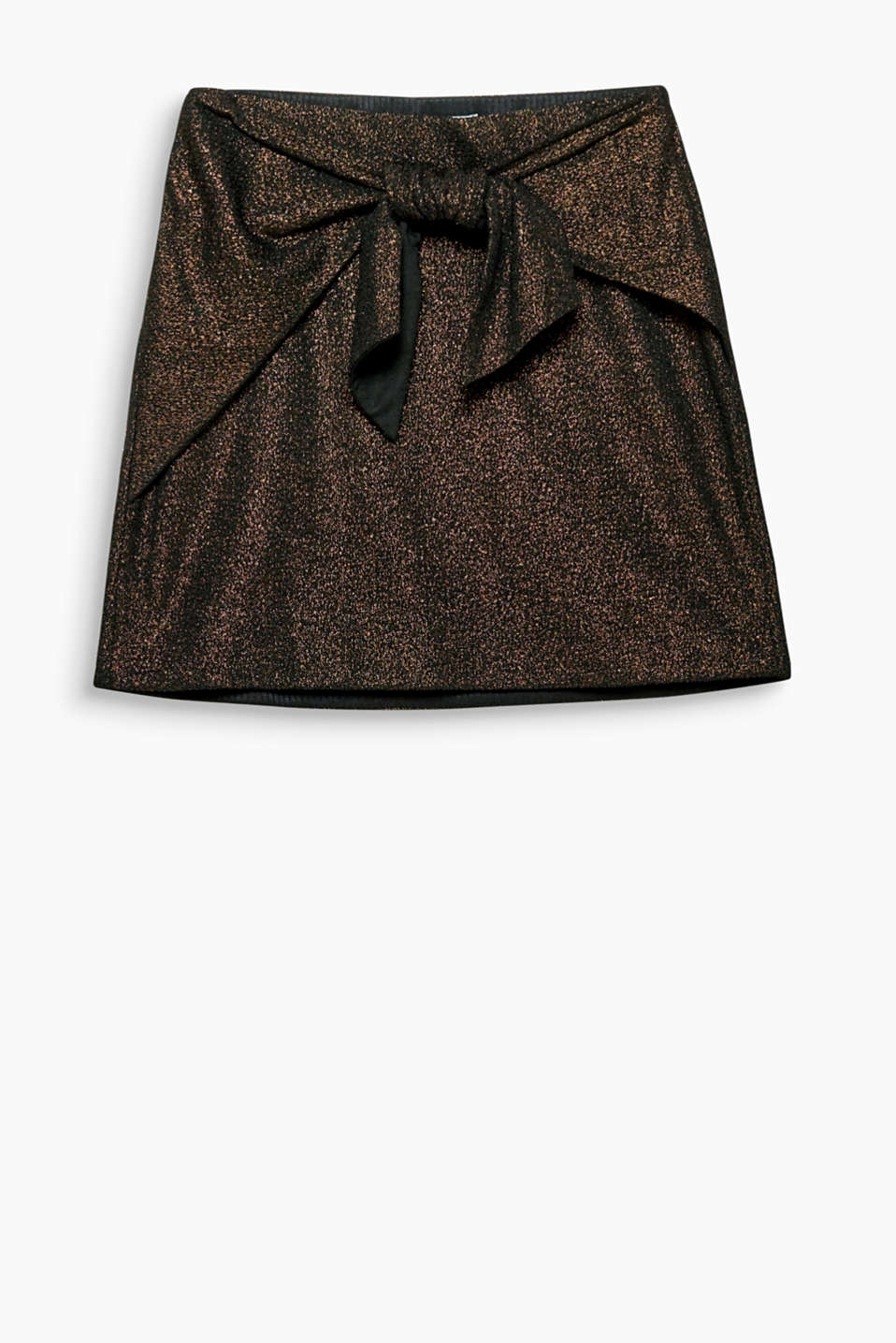 Party all night! This mini skirt is sure to turn heads thanks to the large knotted detail and metallic finish.