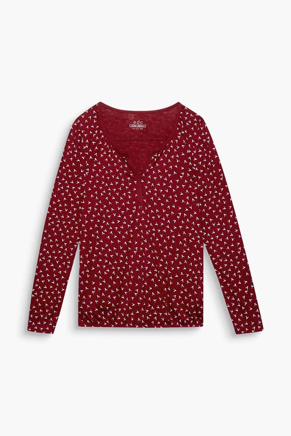 A minimalist bird print and a cup-shaped neckline create a feminine look for this top.