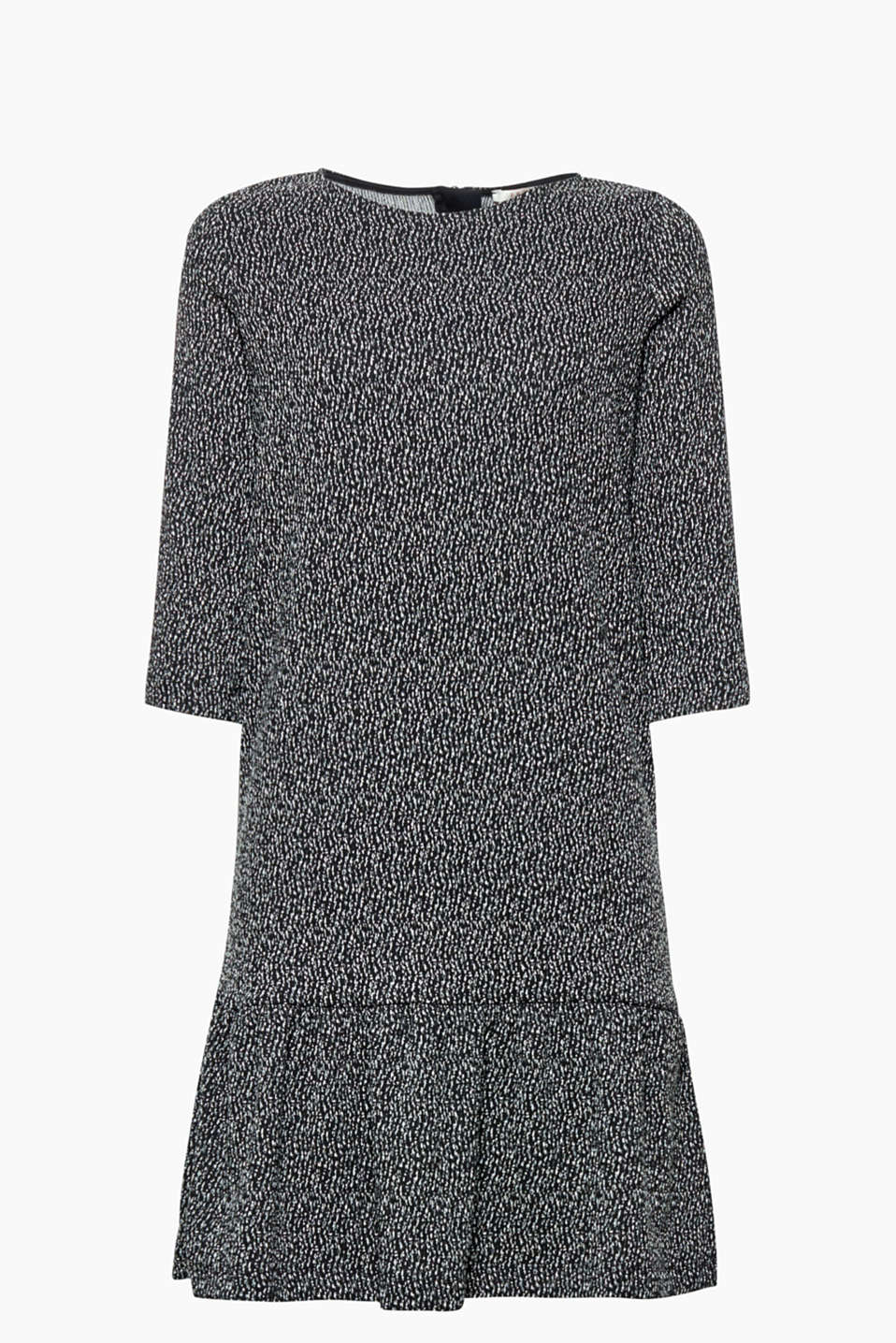 This jersey dress with a two tone texture and swirling skirt gives you a feminine flair and super comfort!