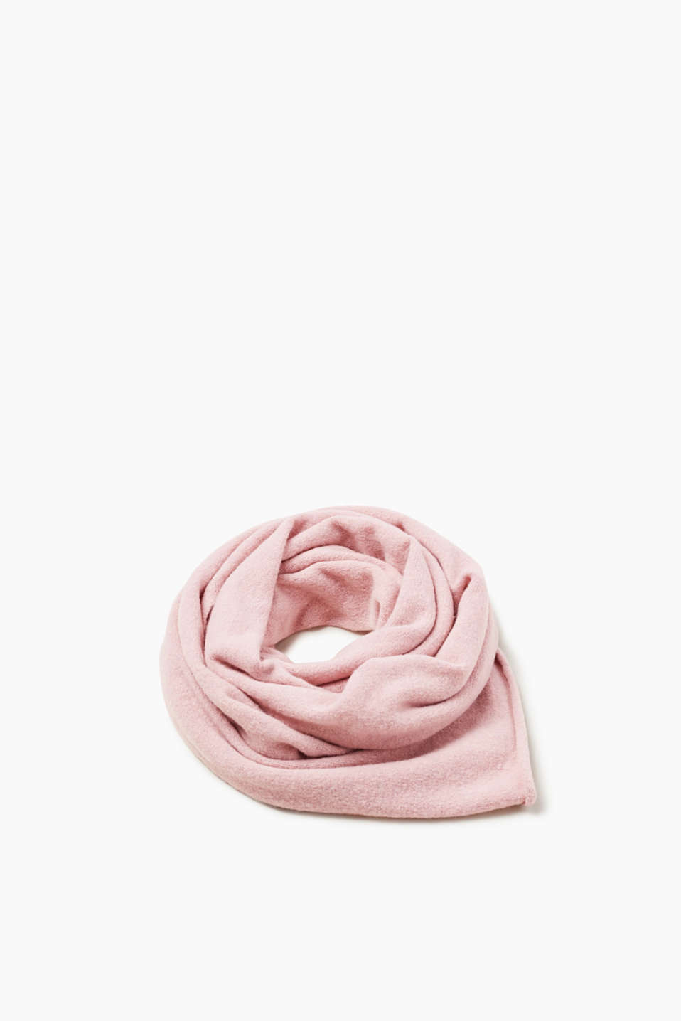For indoors or outdoors, this basic scarf is defined by its narrow rolled edges and elegant percentage of wool.