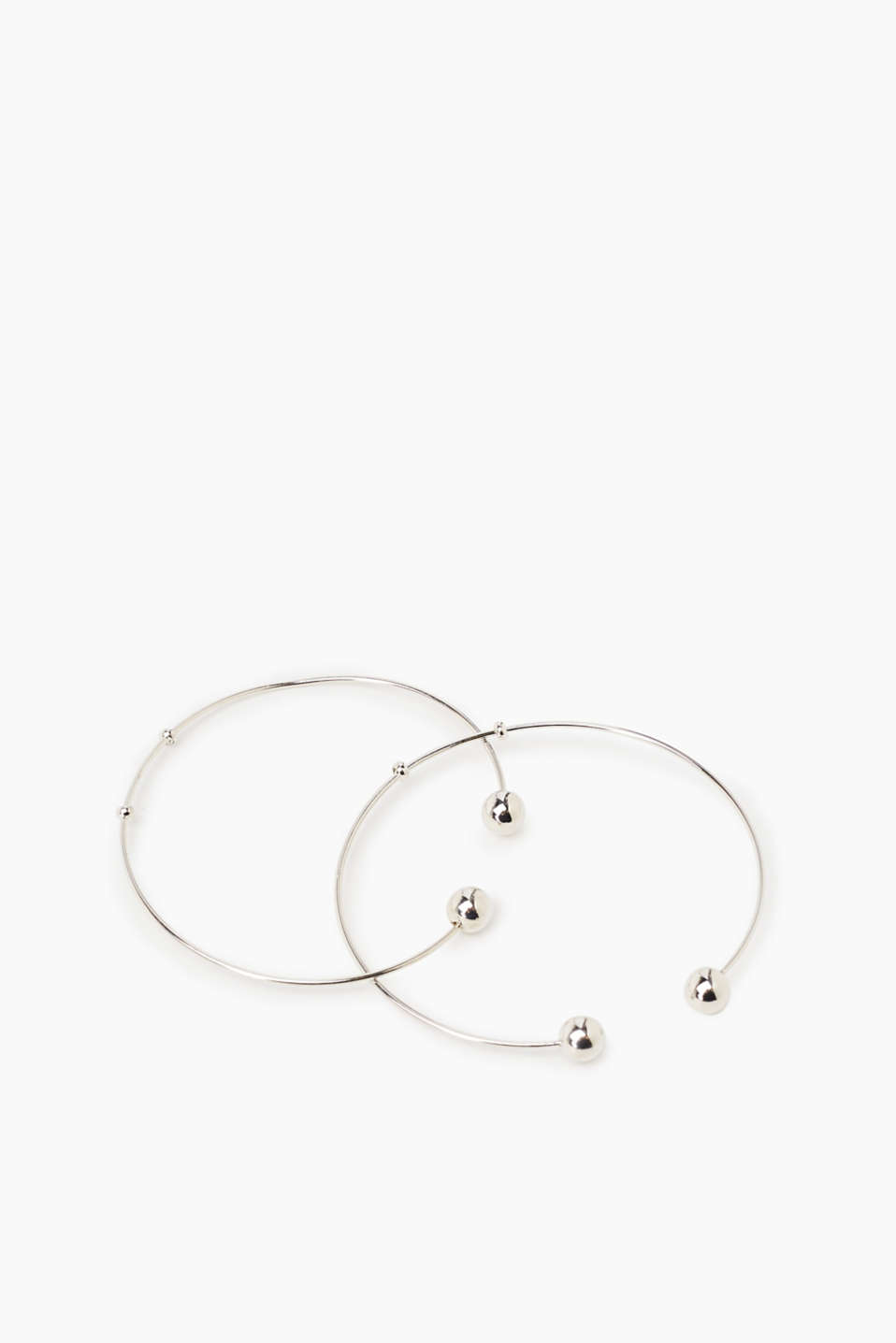 We love minimalist designs! These bangles feature an open design and striking stud details.