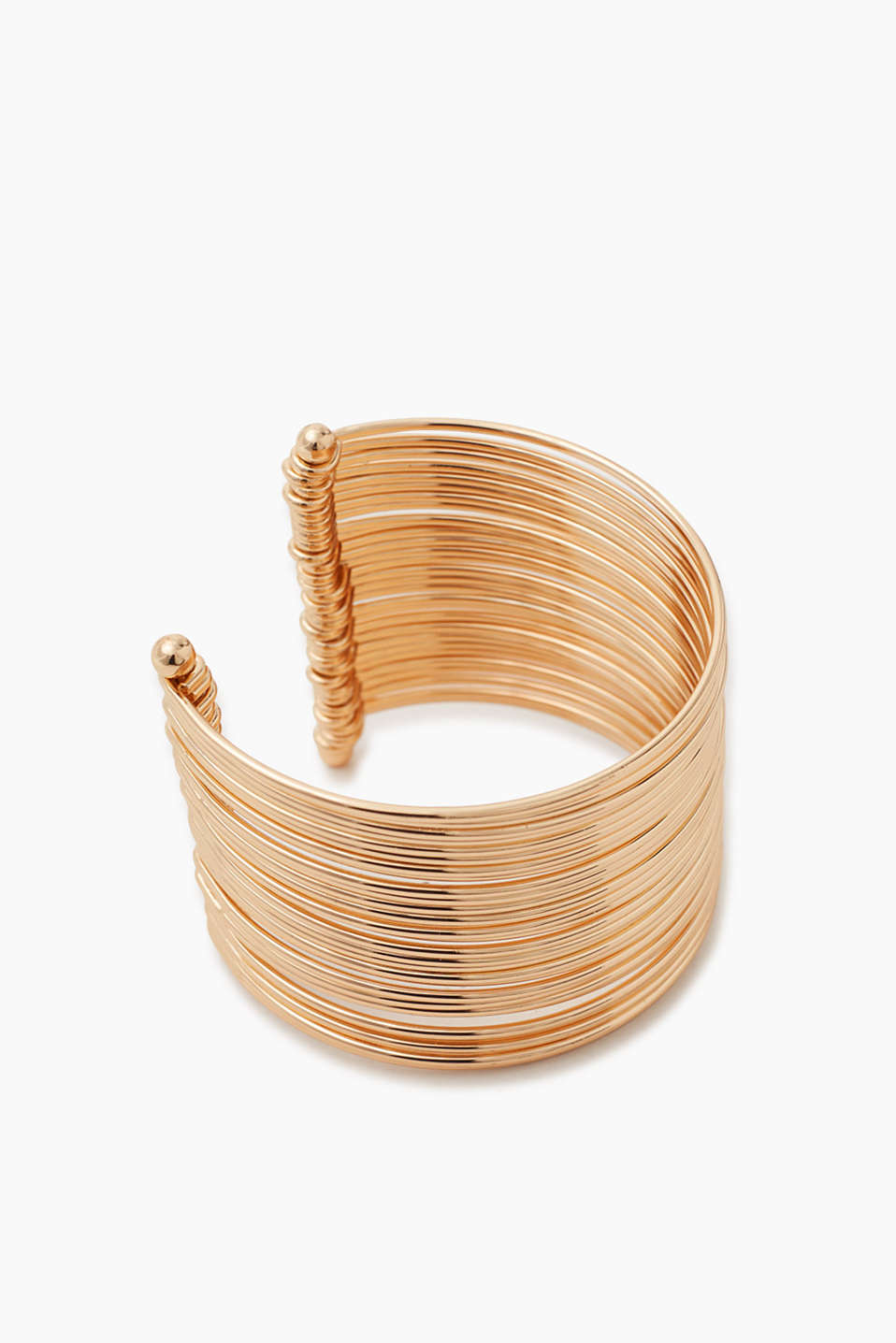 Open bangle made of dense rows of bangles in a gold tone