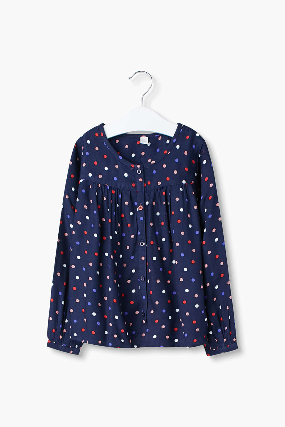 Flowing soft blouse in an A-line design with a charming polka dot pattern.