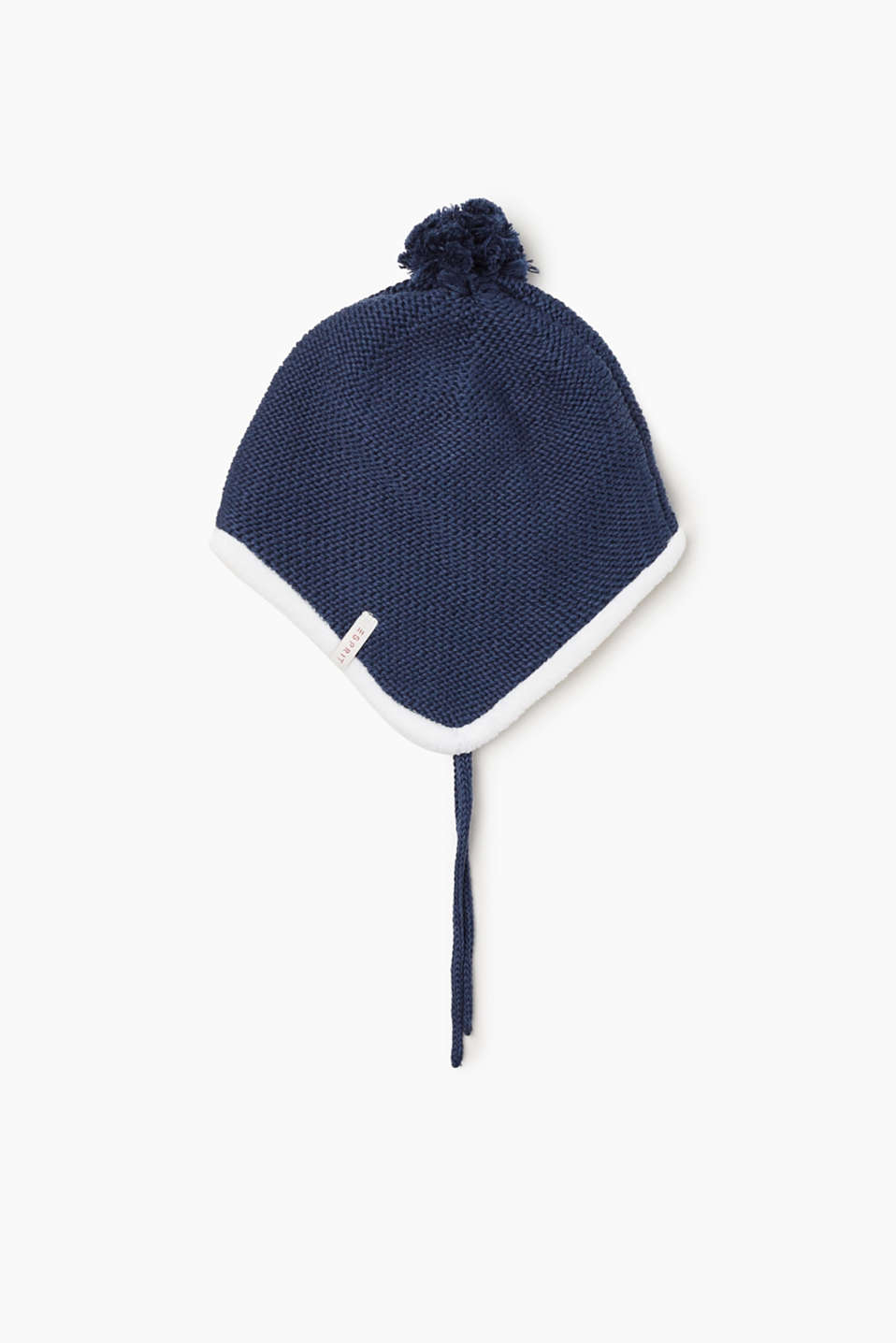 This knit cotton hat with a pompom and warm lining keeps ears warm and looks cute.