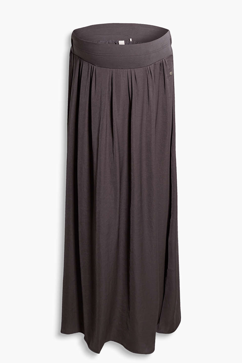 Fluid maxi skirt with high side slits and a supportive under-bump waistband with a beautiful swirl
