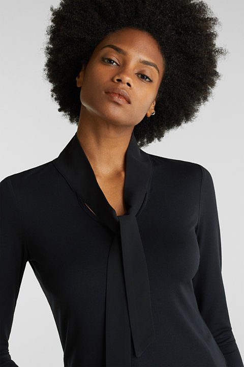 Stretchy long sleeve top with a pussycat bow