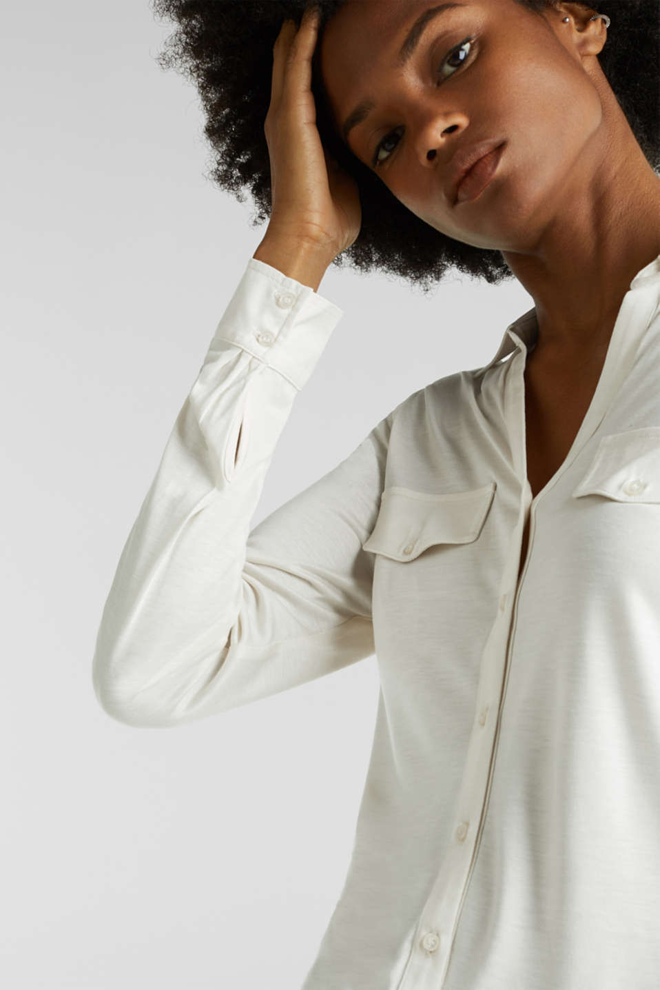 Long sleeve top with an open polo collar