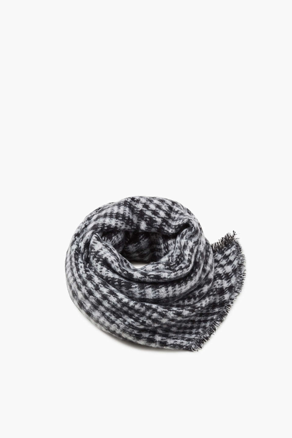 Wrap up in this super fluffy houndstooth scarf with fine fringing and asymmetric ends.