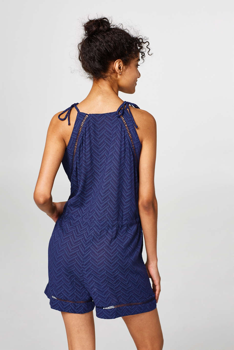 Light jumpsuit with openwork pattern details