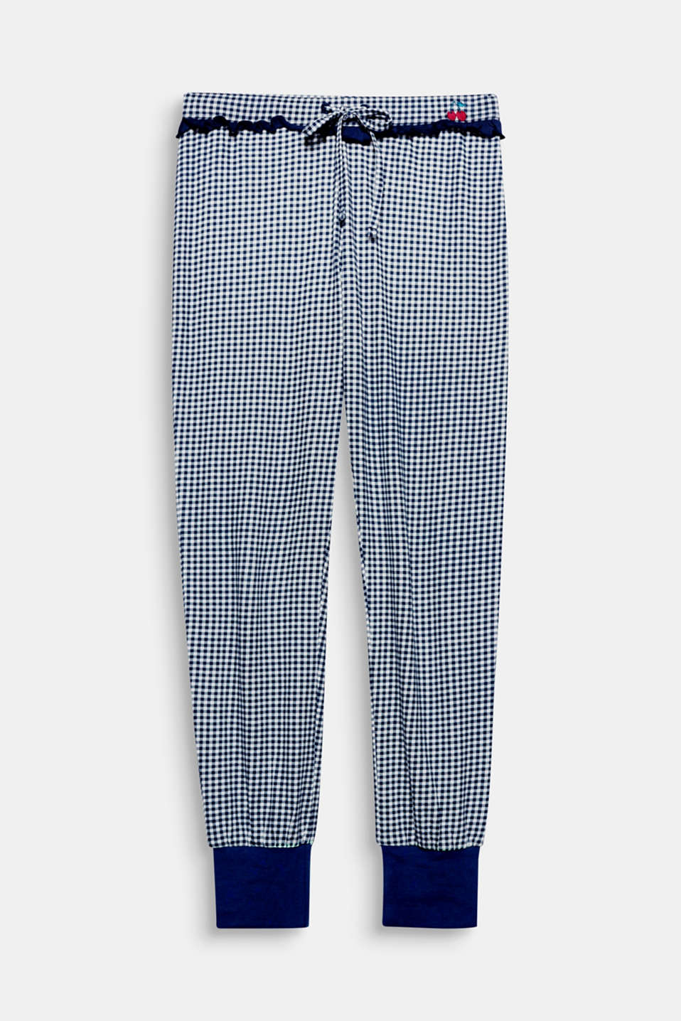 Classic check meets pretty frill details: in these trousers, relaxing is even more fun!