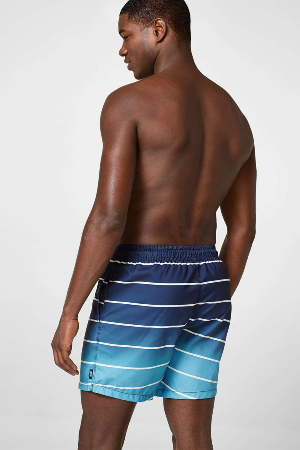 Woven swim shorts with graduated colours