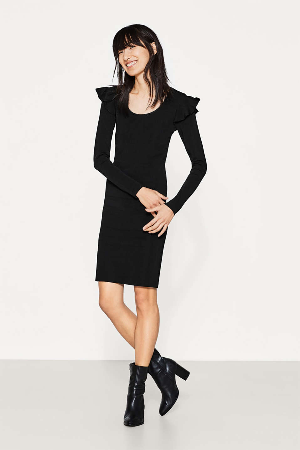 Frilled knit dress with shaping effect