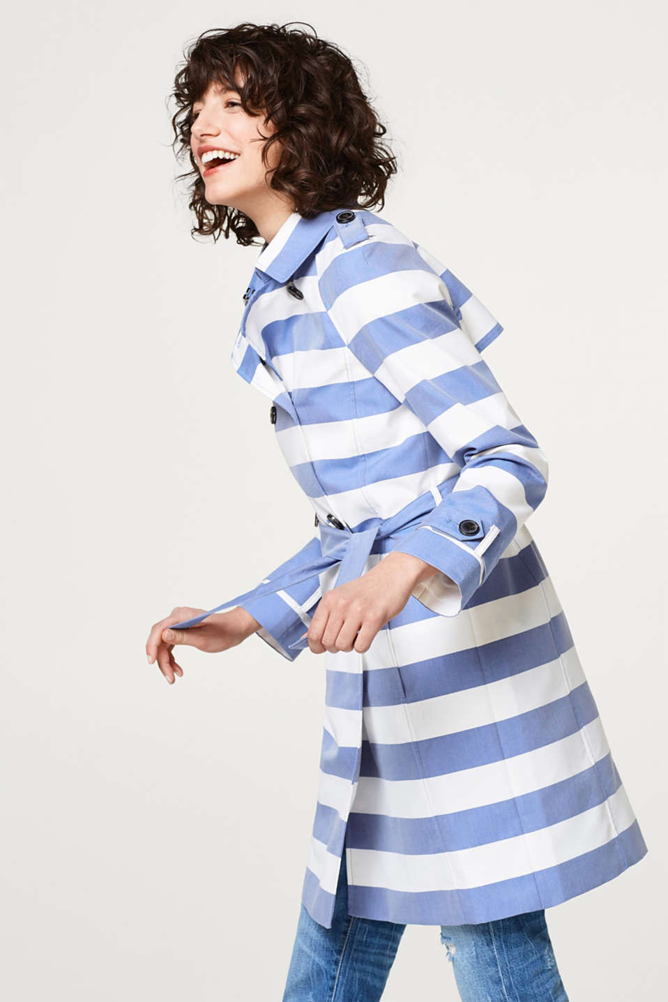 A nautical look for between the seasons! Block stripes turn this blended cotton trench coat into a head-turner.