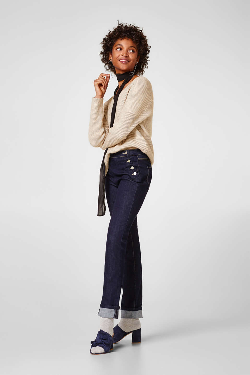 Stretch denim with striking button details