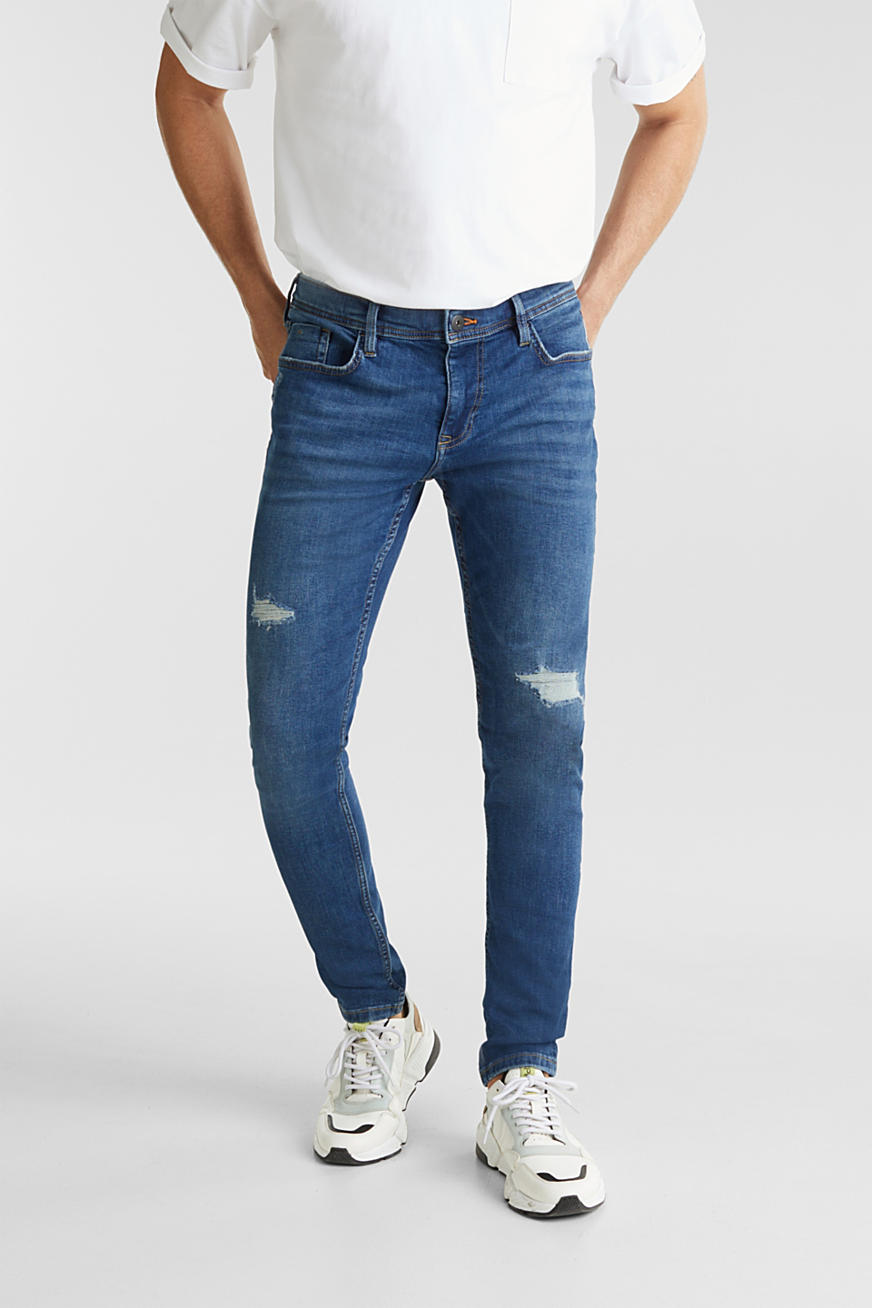 Stretchjeans med destroyed-effekter
