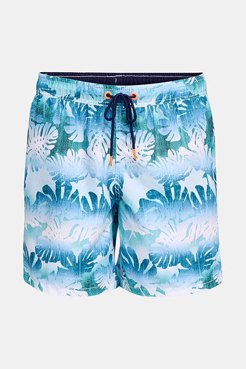 Swim shorts with a tropical print