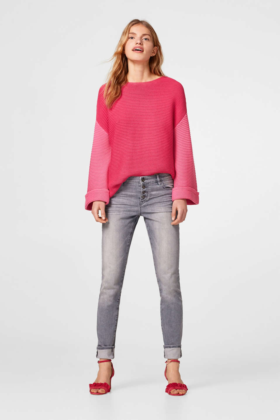 Grey stretch jeans with a button placket