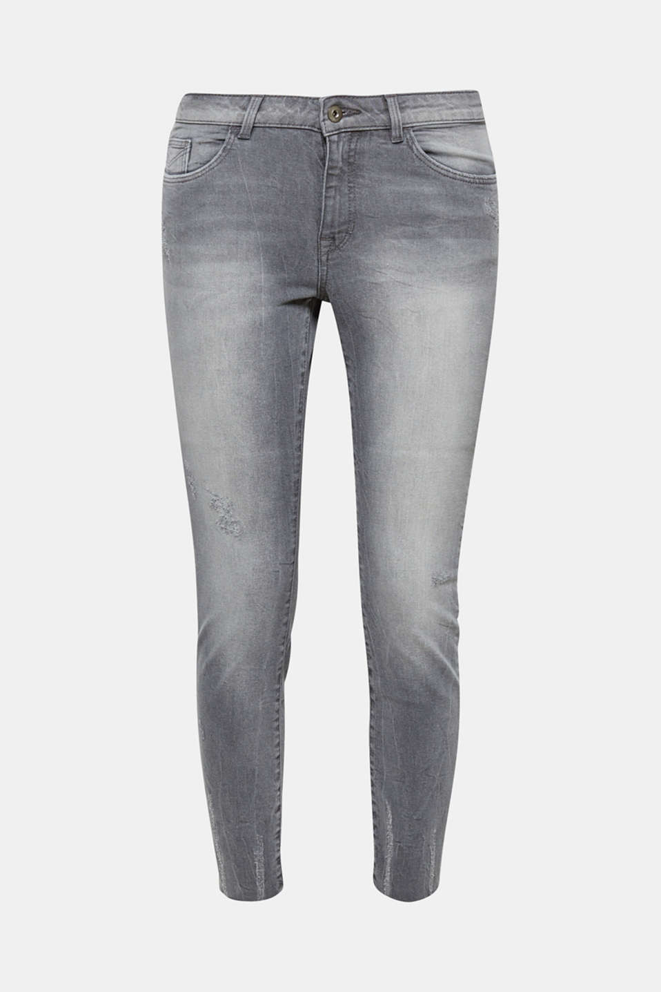 Frayed, cropped leg hems and distressed effects give these jeans a trendy, casual look.