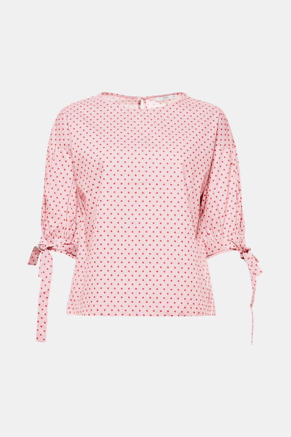 Attention to detail! This blouse is defined by its charming polka dot and stripe print and pretty ties.