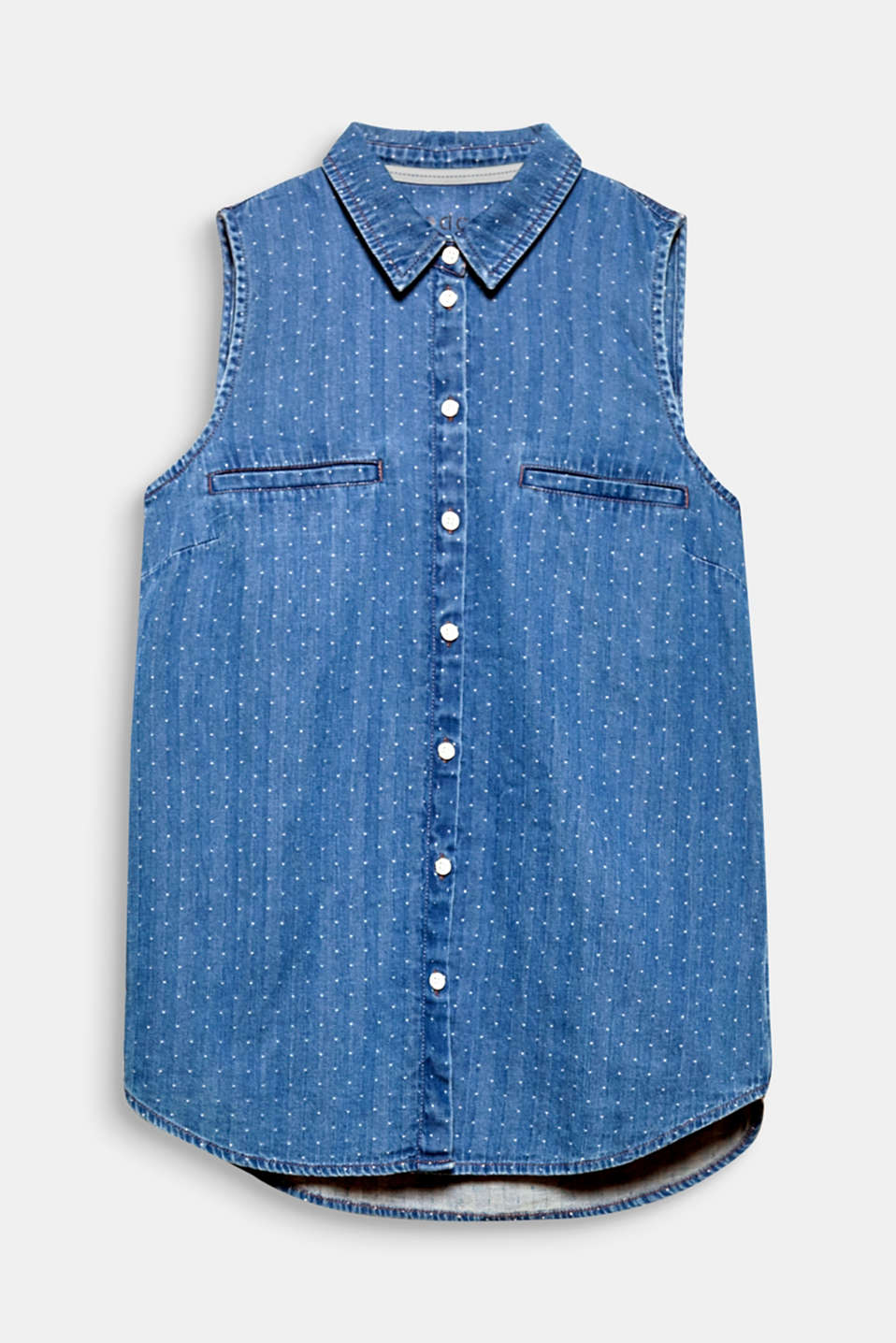 This sleeveless blouse is the perfect springtime companion in soft denim with a fine woven polka dot pattern.