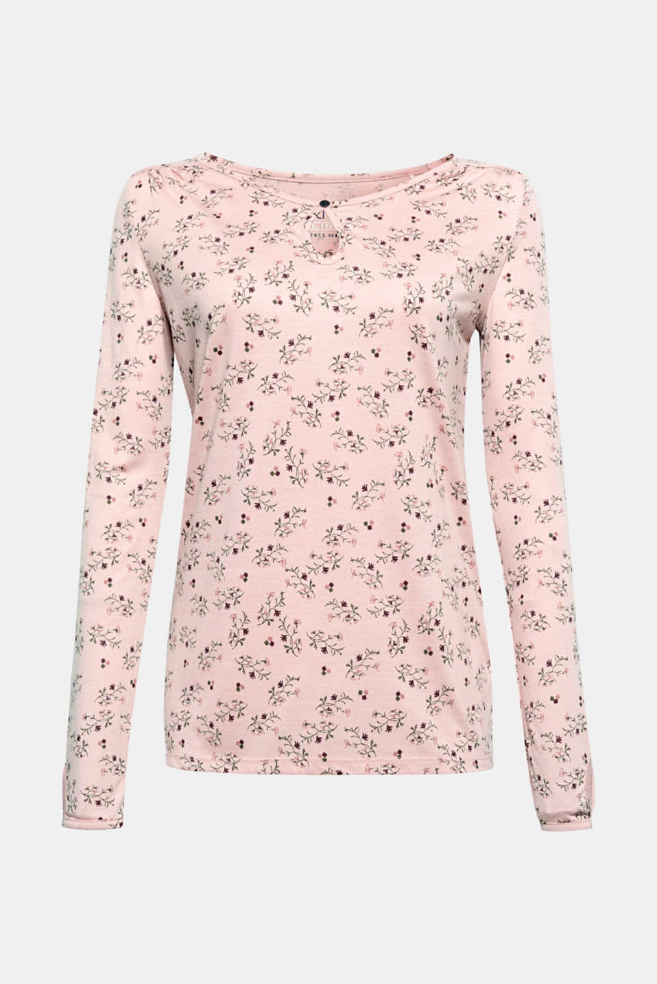 This feminine long sleeve top with a floral tendril print is a versatile all-round talent.
