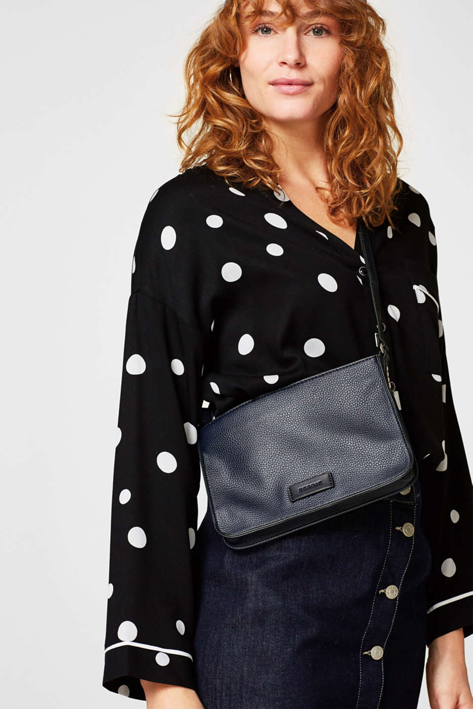 Flat shoulder bag in faux leather