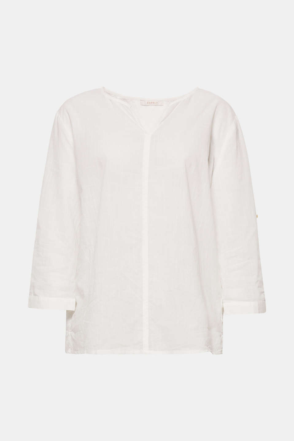 This airy cotton blouse with a tulip neckline and three-quarter length turn-up sleeves is clean and modern!
