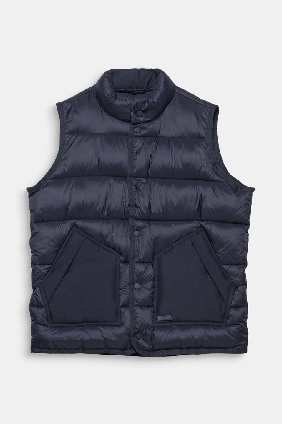 This body warmer with warm padding, a stand-up collar and patch slit pockets is your style partner for between seasons.