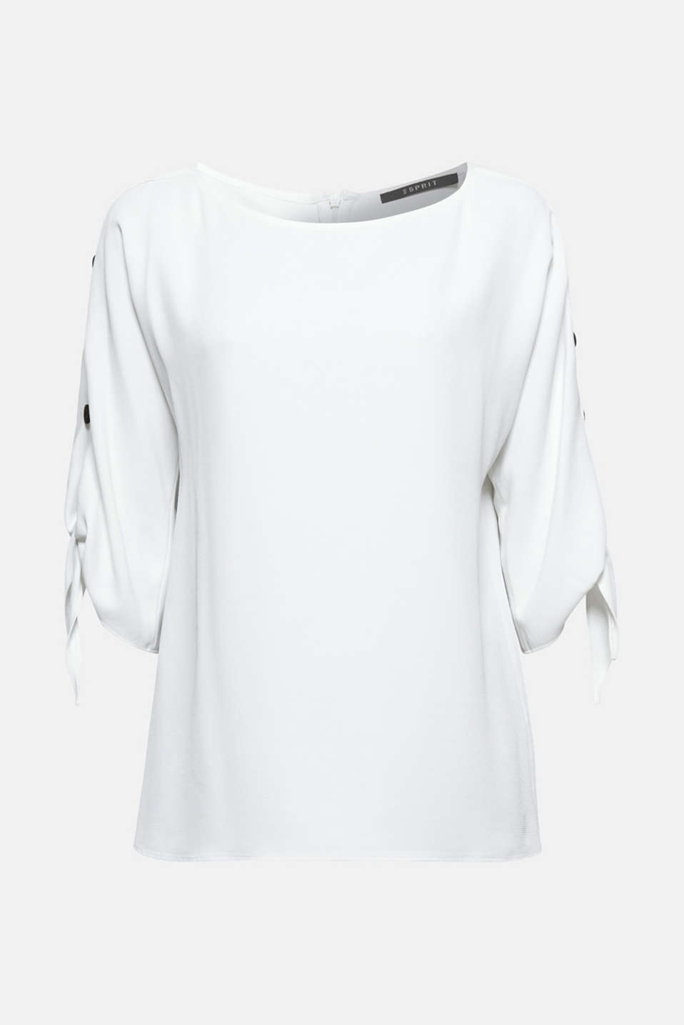Three-quarter length sleeves with knotted ends + buttons in a contrasting colour make this textured blouse so modern!