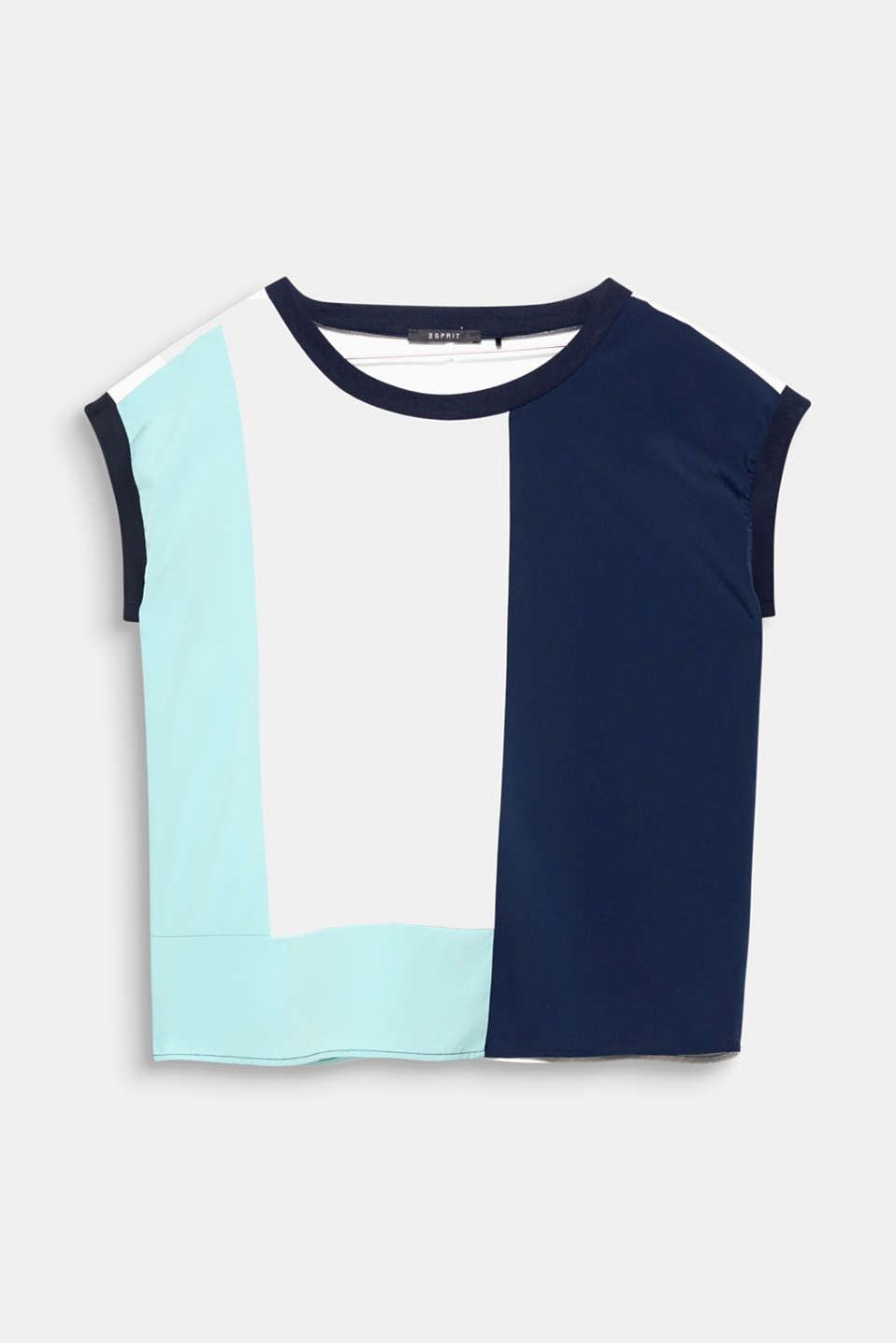 Flowing fabric, modern colour blocking and a sporty ribbed texture make this blouse top so versatile!