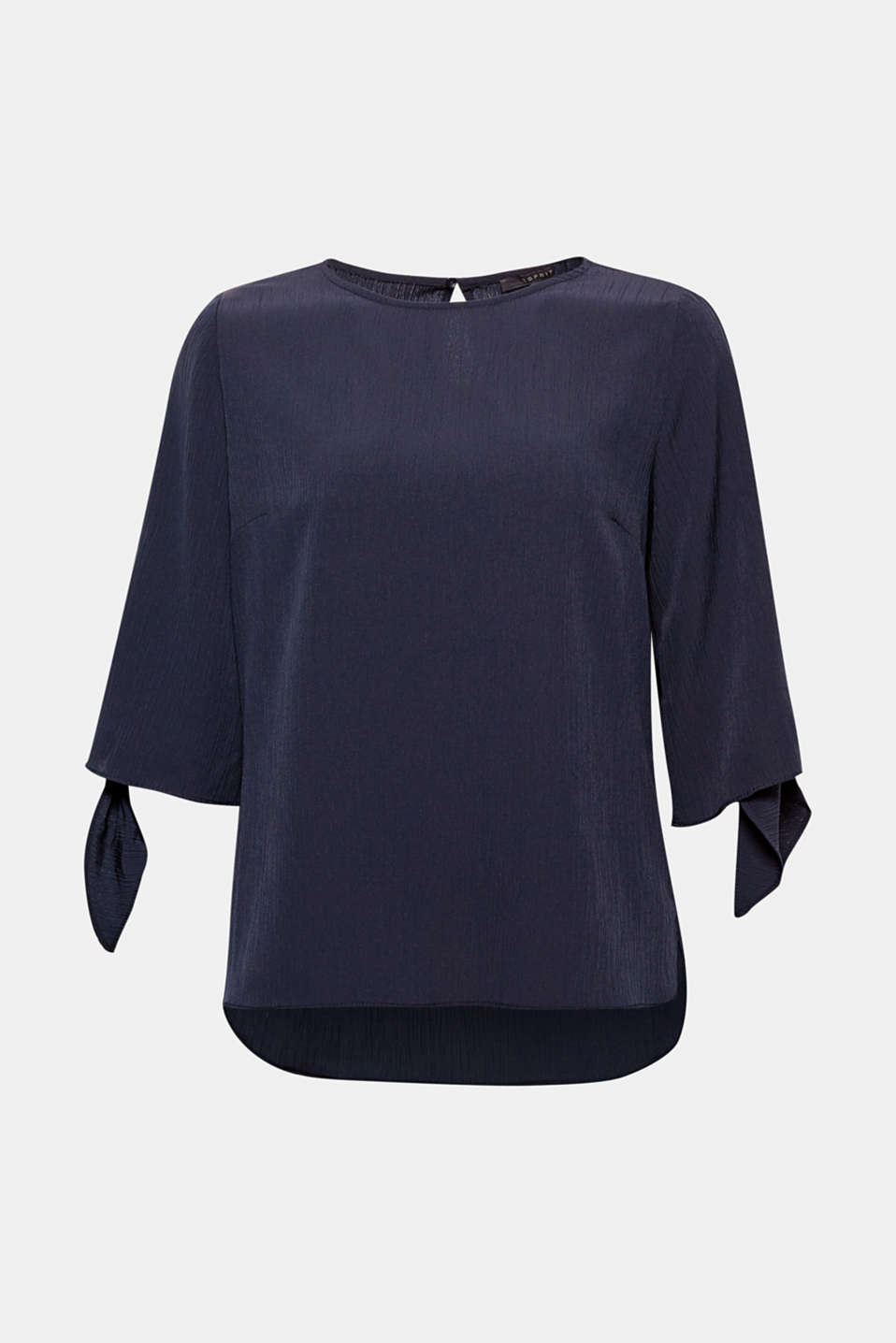 We love feminine details! The knotted sleeve ends and crinkle finish gives this blouse an exciting on-trend look
