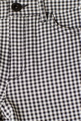 Shaping trousers with shepherd's check pattern