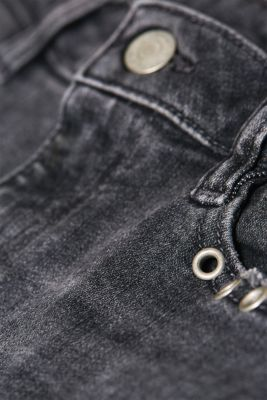 Stretch jeans with decorative eyelets