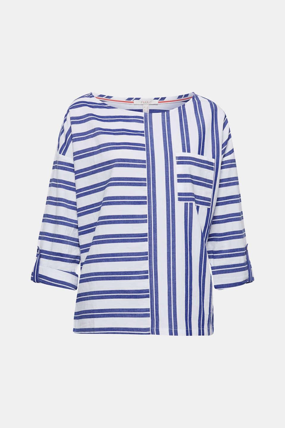 Abwechslung fürs Auge bietet diese Boxy-Bluse dank des modischen Streifen-Musters. Praktisch bei wechselnden Temperaturen: die längenverstellbaren Ärmel.
