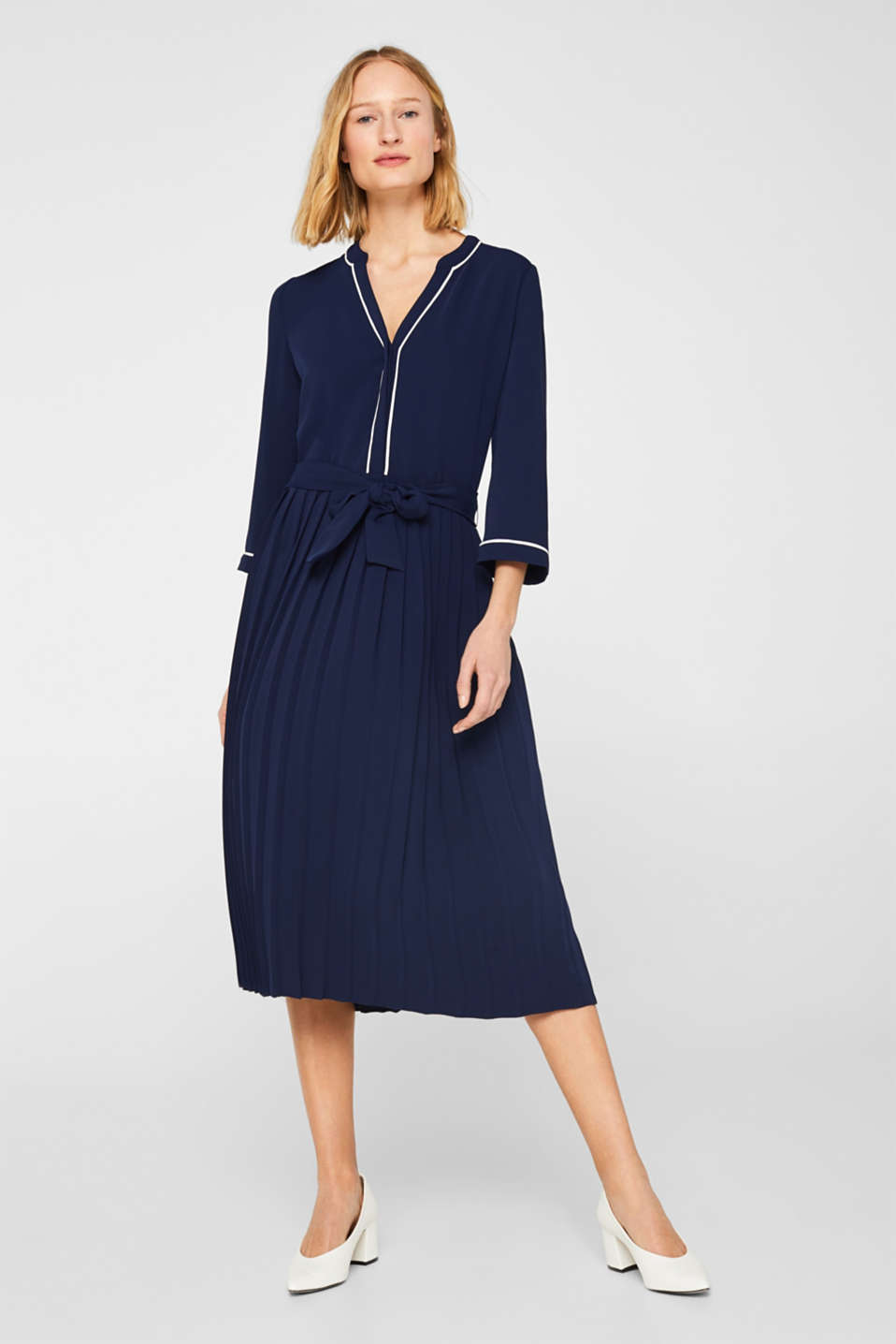 Piped shirt dress with a pleated skirt